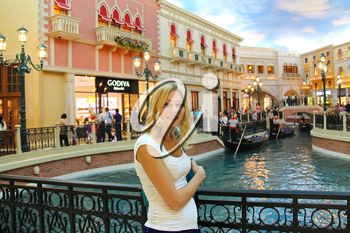 LAS VEGAS, NEVADA, USA - OCTOBER 20 : Young woman in Venetian  Hotel on October 20, 2013 in Las Vegas, The resort opened on May 3, 1999. One of the most luxurious hotels in Las Vegas
