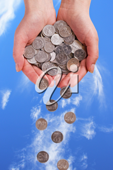 Royalty Free Photo of a Person Holding Coins