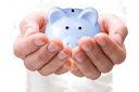 Royalty Free Photo of a Person Holding a Piggy Bank