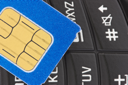 Royalty Free Photo of a SIM Card on a Phone