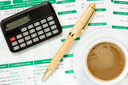 Calculator and coffee cup  in an environment of financial calculations