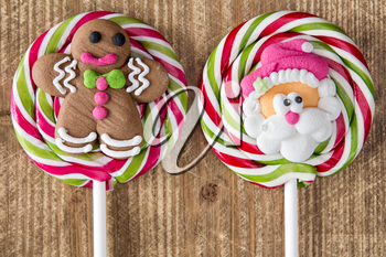 Christmas lollipops with gingerbread man and face of Santa