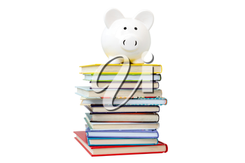 Piggy bank on a stack of books, isolated on white background