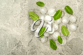 Ice pieces with fresh mint leaves, top view