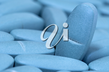 Medical blue pills macro background. Medicine concept of viagra, medication for stomach, erection, sleeping, digestive, drugs.