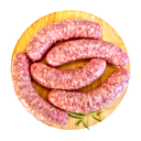 Pork sausage with rosemary on a circular wooden board isolated on white background