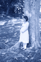 Pregnant woman holding belly wishing everything goes well in the forest