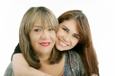 Photo of attractive woman and her young daughter looking at camera
