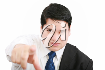 Portrait of an angry young business man in suit pointing at you isolated over white background