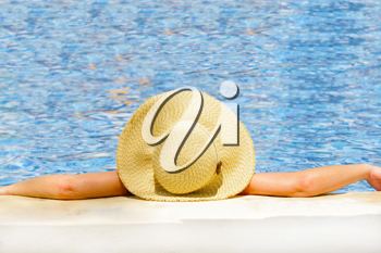 Woman in hat relaxing on holiday