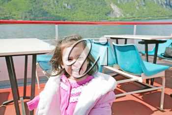 playful pretty little girl on sail boat in Lugano