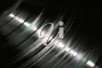 Segment of vinyl record showing the texture of the grooves