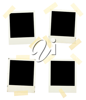 Royalty Free Photo of a Series of Instant Photos Taped to a Board