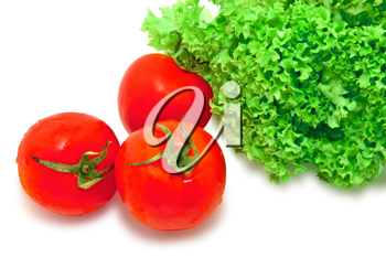 Closeup image of three red tomatoes and green lettuce, isolated on white background