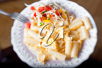 Pasta with salad from tomato and cabbage, selective focus