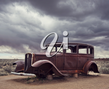 Route 66 vintage car relic displayed near the north entrance of Petrified Forest National Park in Arizona, USA