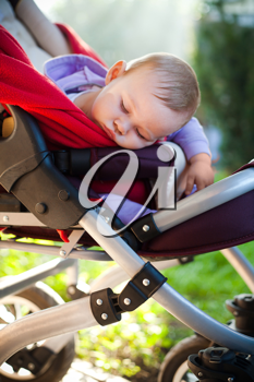 Photo of baby  sleeping peacefully outdoors