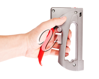 Professional staple gun in the hand isolated over white background