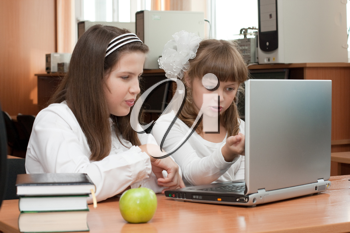 Royalty Free Photo of Two Students Using a Laptop