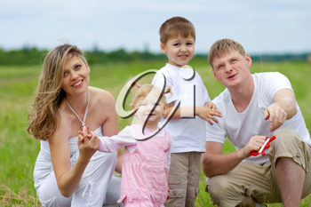 Royalty Free Photo of a Family Flying a Kite