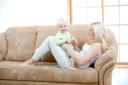 Royalty Free Photo of a Mother and Son Playing on a Sofa
