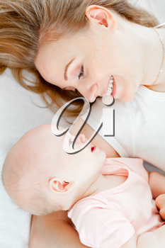 Royalty Free Photo of a Mother Holding Her Baby