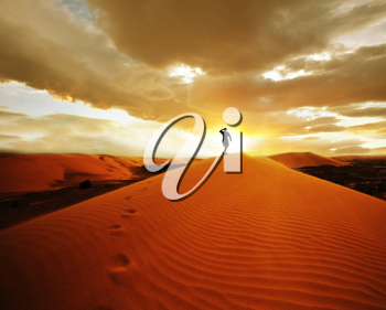 Royalty Free Photo of a Hike in the Gobi Desert at Sunset