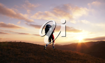 Royalty Free Photo of a Woman Hiking at Sunset