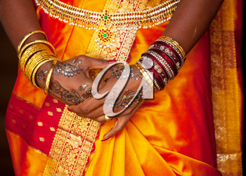 bangles, rings and wedding pattern on hands