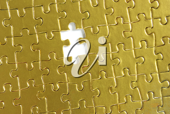 Royalty Free Photo of a Gold Puzzle