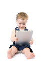 Baby girl playing with tablet