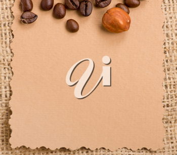 Royalty Free Photo of a Piece of Paper and Coffee Beans