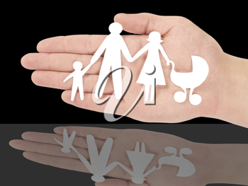 Royalty Free Photo of a Person Holding a Paper Family