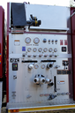 Royalty Free Photo of a Firetruck Hose With Gauges