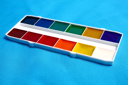 coloured paints for drawing isolated on blue background