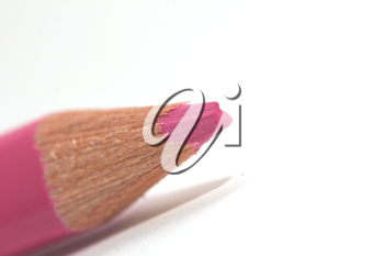 pink pencil on a white background. macro