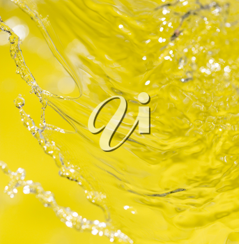 water on a yellow background