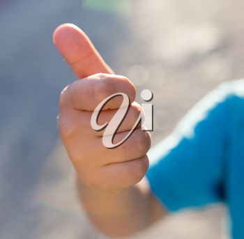 boy's hand with thumb up