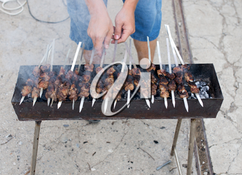 Cooking barbecue sticks on the grill in the open air