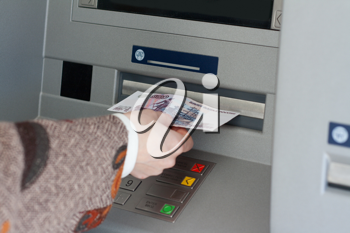 Royalty Free Photo of a Woman Using a Bank Machine