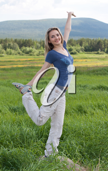 Royalty Free Photo of a Girl Stretching in a Field