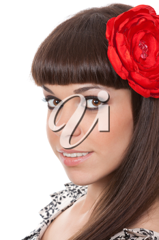 beautiful young brunette woman with an red fabric flower in her hair
