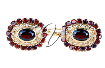 gold earrings with ruby isolated on white