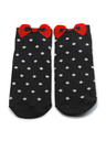 Pair of black socks with white polka dots with a red bow. Isolate.