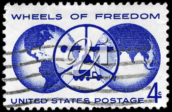 Royalty Free Photo of 1960 US Stamp Shows the Globe and Steering Wheel With Tractor, Car and Truck, Inscribed Wheels of Freedom