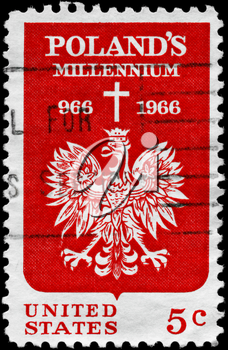 Royalty Free Photo of 1966 US Stamp Shows the Polish Eagle and Cross, for 1000th Anniversary of Christianity in Poland