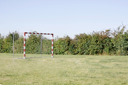 Royalty Free Photo of a Soccer Net in a Field