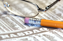Royalty Free Photo of a Pair of Glasses on a Newspaper