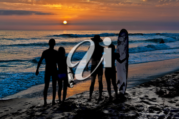 Royalty Free Photo of Two Couples on the Beach at Sunset