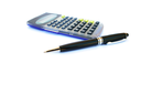 Royalty Free Photo of a Calculator and Pen